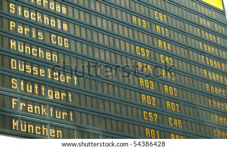 Timetable display screen of arrivals and departures at station or airport - stock photo