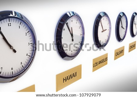 Timezone clocks showing different times of world locations - stock photo