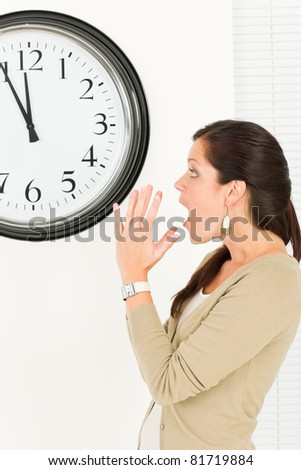 Timing - Surprised face expression businesswoman casual looking at clock