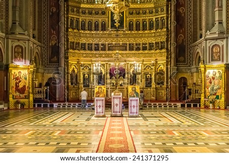 TIMISOARA, ROMANIA - AUGUST 25, 2014: The Timisoara Orthodox Cathedral is the seat of the Archbishop of Timisoara and Metropolis of Banat and is dedicated to the Three Holy Hierarchs. - stock photo