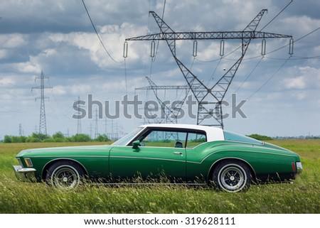 TIMISOARA, ROMANIA, May 11 2015: Buick Riviera 1972 on a field - stock photo