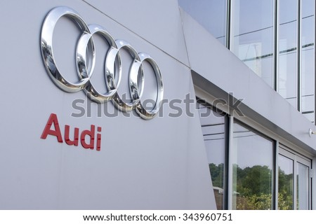 Timonium, MD - August 8, 2012: Audi Logo Sign Next to Door at Dealership - stock photo