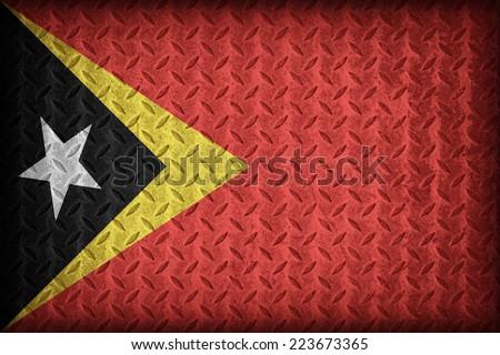 Timor flag pattern on the diamond metal plate texture ,vintage style - stock photo