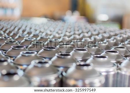Tin blank tubes in rows - stock photo