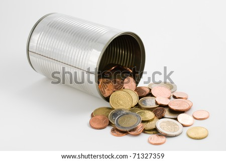 Tin can and euro coins isolated on white background - stock photo