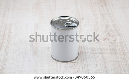 tin can on white wood background. - stock photo
