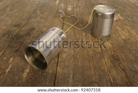 tin can phone with heart shape in wire - stock photo
