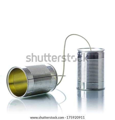 Tin cans telephone on white background - stock photo