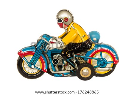 Tin motorcycle clockwork toy isolated on white