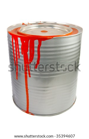 Tin of a red paint. Isolated over white