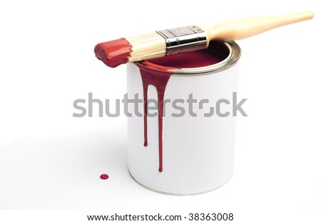 Tin of red paint and paint brush - stock photo