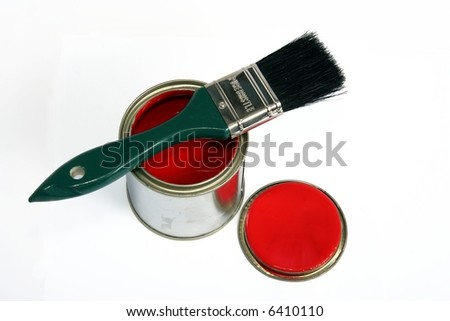 Tin of red paint with lid and brush with green handle on white background - stock photo