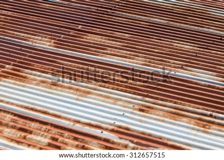 Tin roof with rust - stock photo