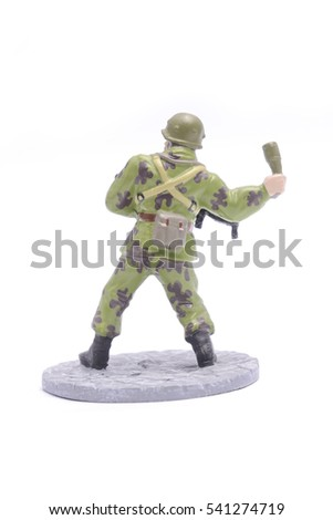 Tin Soldier throws grenade isolated on white