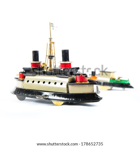 Tin toy boats over isolated white background