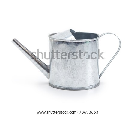 Tin watering can isolated on white. - stock photo