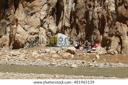 TINERHIR, MOROCCO - AUGUST 19: Locals relaxing and playing in the river at Todgha Gorge, near Tinerhir in Morocco on the 19th August, 2015.