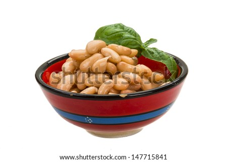 Tinned bean with basil leaf - stock photo
