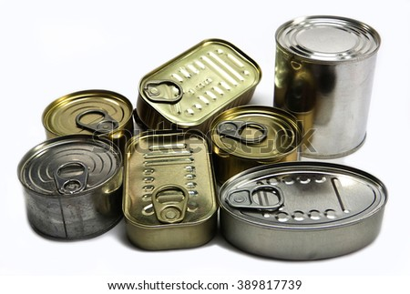Tins of different sizes and opening - stock photo