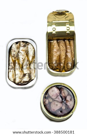Tins of different sizes and opening, mackerel in vegetable oil, sardines and Octopus - stock photo