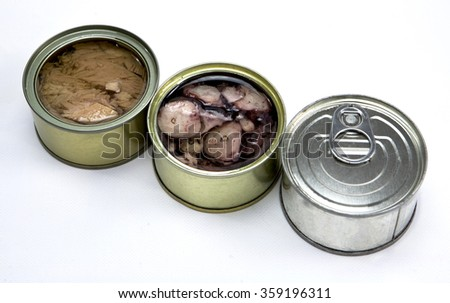 Tins of sardines and mackerel in different sizes open isolated on a white background - stock photo