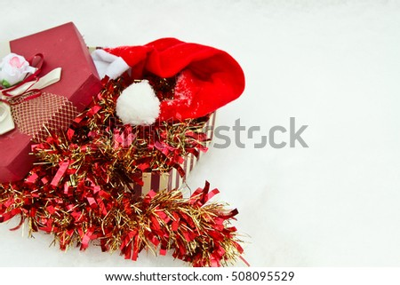 tinsel with gift and santa hat
