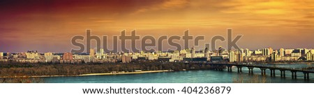 Tinted evening cityscape of Kiev. Panorama of the left bank of the Dnieper.