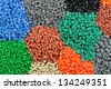 tinted plastic granulate for injection moulding process - stock photo