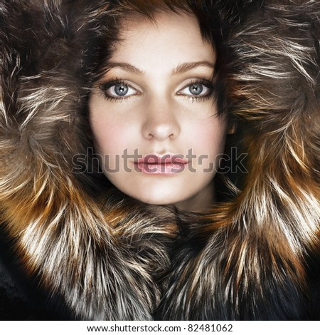 tinted portrait of woman in hood - stock photo