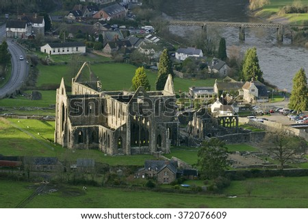 Tintern Abbey & The River Wye, viewed from near the Devils Pulpit - stock photo