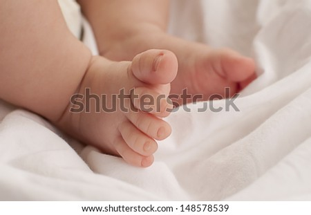 Tiny Baby Feet - stock photo