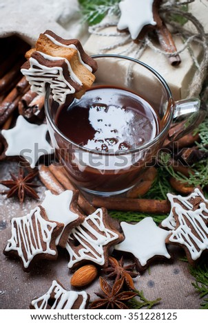 Tiny  Chocolate Christmas Cookies in a Star Shape with Icing Sugar on Cup - stock photo