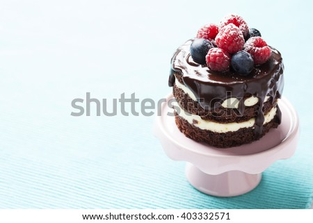 Tiny chocolate naked cake with fresh berries