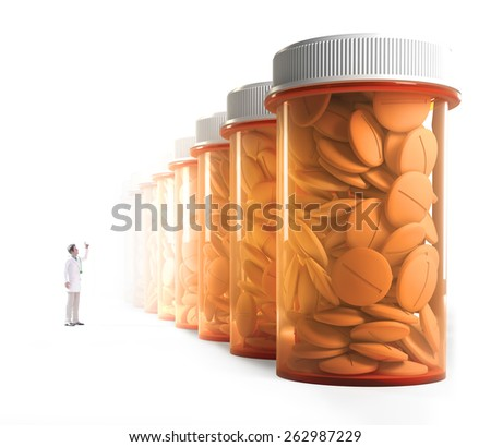 Tiny doctor observing a row of orange medicine containers - stock photo