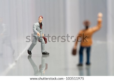 Tiny little model figurines of business colleagues greeting one another while walking to work - stock photo