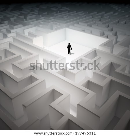 Tiny man inside an endless maze - stock photo