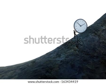 Tiny man pushing a huge clock up hill - stock photo