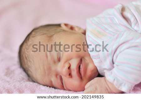 tiny newborn just after birth
