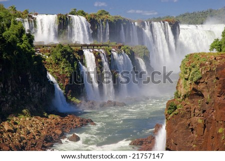 Tiny people on catwalks at the Iguazu Falls - The Devil's Throat - stock photo
