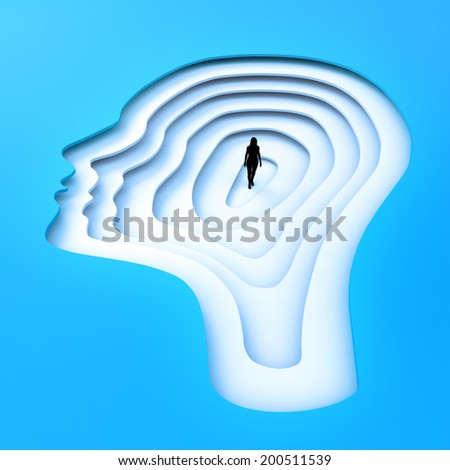 Tiny person standing inside a female head silhouette. - stock photo