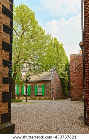 Tiny street in the Old city center of Dusseldorf in Germany. It is the capital of Rhine Westphalia region.