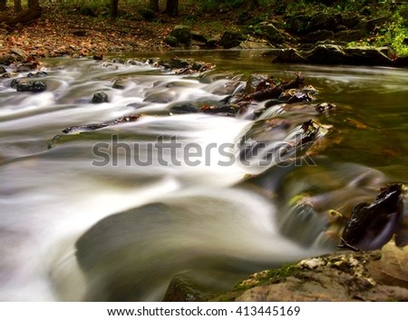 Tiny Waterfalls Cascade Through the Forest - stock photo