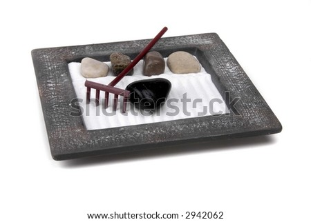 Tiny zen garden with interesting arrangement of items - stock photo