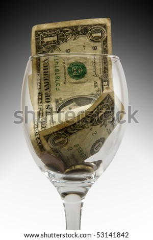 tip in a glass with money - stock photo