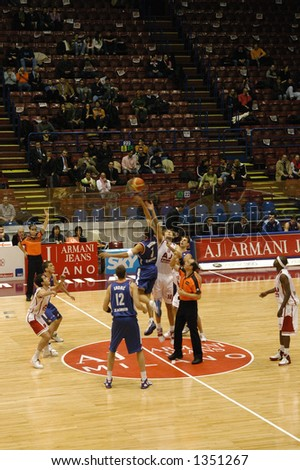 Tip-off at a basketball game in Milan, Italy - stock photo