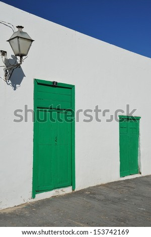 Tipical house on Canary island with green closed wood door lanzarote abstract spain  - stock photo