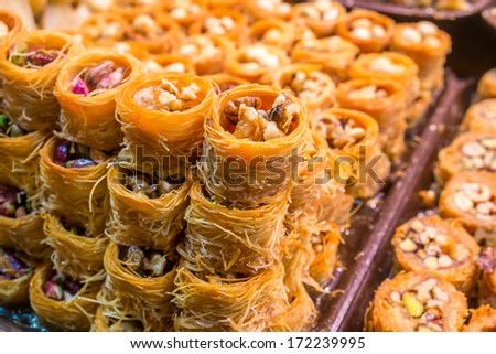 Tipical turkish baklava pastries on sale at the market in Istanbul - stock photo