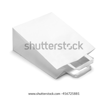 Tipped Over White Paper Bag Isolated on White Background.