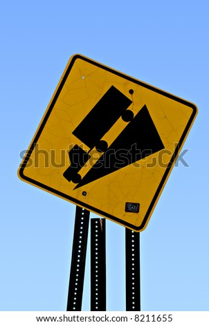 Tipped road sign of truck on hill