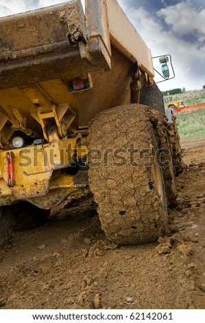 Tipper truck with a muddy rear wheel - stock photo